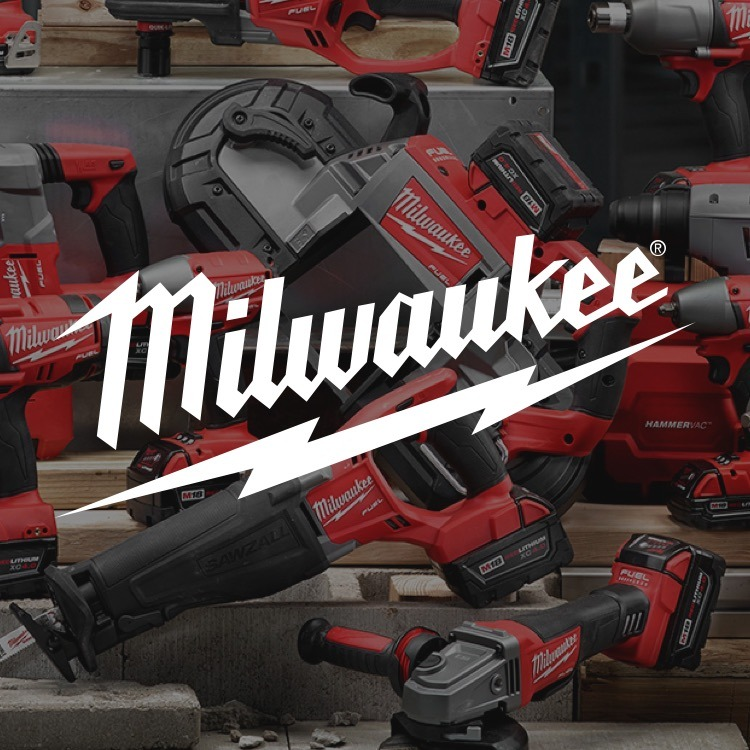 A broad selection of Milwaukee power tools are arranged in an artful still life.