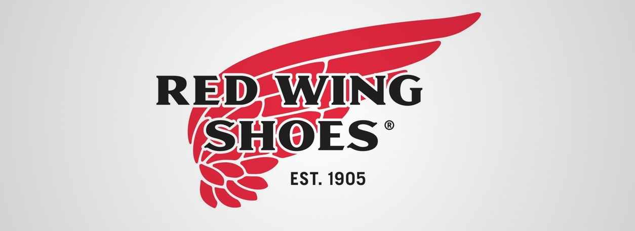 The red Wing logo on a tasteful, light grey backgrouns
